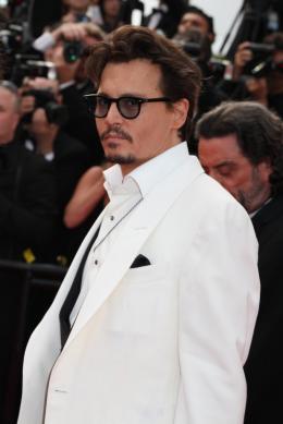 photo 78/140 - Johnny Depp - Montée des marches de Pirates des Caraïbes : La fontaine de Jouvence - Pirates des Caraïbes : La fontaine de Jouvence - © Isabelle Vautier pour CommeAuCinema - Cannes 2011