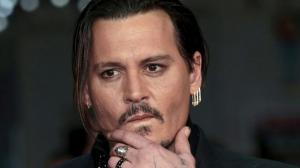 Johnny Depp enqu�te sur les meurtres de Tupac et Notorious B.I.G.